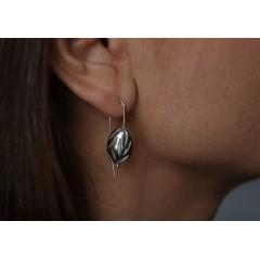 Hängande örhängen med utsågat mönster